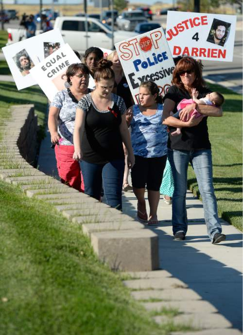 Francisco Kjolseth | The Salt Lake Tribune Susan Hunt, right, is joined by family, friends and supporters on the one-year anniversary of the death of her son Darrien Hunt at the hands of police in Saratoga Springs.