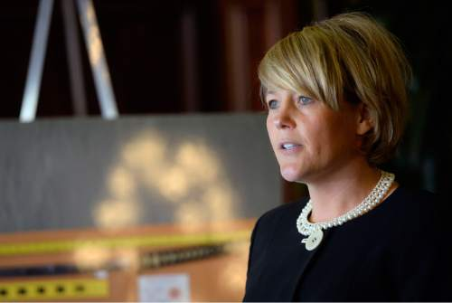 Al Hartmann  |  The Salt Lake Tribune Attorney Heather White, who is representing Saratoga Springs, holds a press conference on the city's response to a civil rights lawsuit filed earlier this month by the family of Darrien Hunt, the 22-year-old sword-wielding man who was fatally shot on Sept. 10 2014, by two Saratoga Springs police officers. To her left is a photo of the sword Hunt was carrying when he was shot.