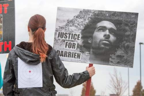 Rick Egan  |  The Salt Lake Tribune  A supporters wear a target on her back  during a rally in  Saratoga Springs for justice for Darrien Hunt, Friday, November 14, 2014