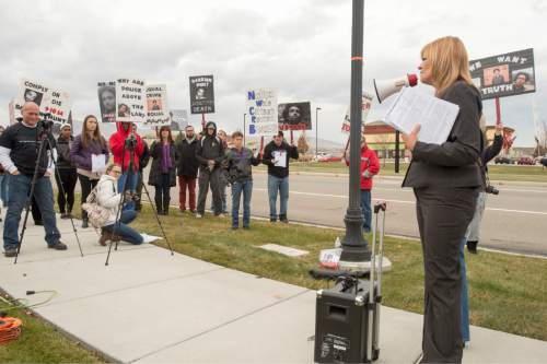 Rick Egan  |  The Salt Lake Tribune  Darrien Hunt's aunt, Cindy Moss, makes a speech to supporters, during a rally in  Saratoga Springs , for justice for Darrien Hunt, Friday, November 14, 2014