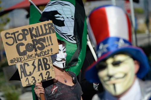Francisco Kjolseth | The Salt Lake Tribune The group known as Anonymous shows their support as they join those gathered nn the one-year anniversary of the death of Darrien Hunt at the hands of police in Saratoga Springs.