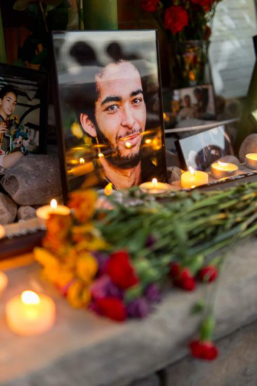 Trent Nelson  |  The Salt Lake Tribune Photos, notes, flowers and a wooden sword at a memorial to Darrien Hunt Sunday September 14, 2014 at the Saratoga Springs Panda Express, where Hunt was shot and killed by police.