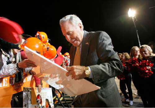 Scott Sommerdorf  l  The Salt Lake Tribune  ESPN GameDay analyst Lee Corso autographs a sign for a Ute fan before the show began. The ESPN College GameDay program did its broadcast at the University of Utah prior to the TCU at Utah game, Saturday, November 6, 2010.