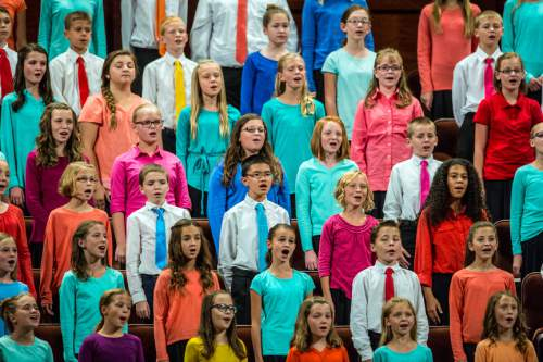 Chris Detrick  |  The Salt Lake Tribune Primary children from Riverton sing during afternoon session of the 185th LDS General Conference at  the Conference Center in Salt Lake City Saturday October 3, 2015.