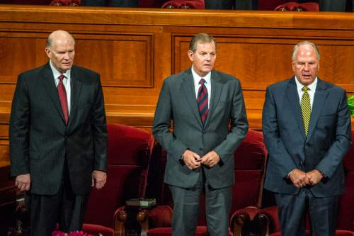 Chris Detrick  |  The Salt Lake Tribune New apostles Dale G. Renlund, Gary E. Stevenson and Ronald A. Rasband sing during afternoon session of the 185th LDS General Conference at  the Conference Center in Salt Lake City Saturday October 3, 2015.
