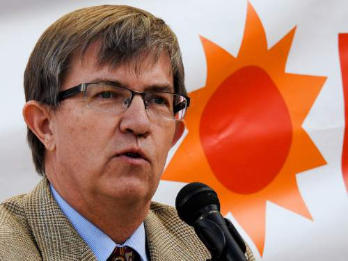 Trent Nelson  |  The Salt Lake Tribune Rep. Joel Briscoe (D- Salt Lake) speaks to clean energy advocates gathered outside the Utah Public Service Commission (PSC) in Salt Lake City, Thursday October 8, 2015, before a hearing on fees levied by utilities on rooftop solar users.