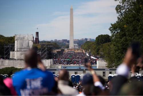 A view of the crowd during a rally to mark the 20th anniversary of the Million Man March, on Capitol Hill, on Saturday, Oct. 10, 2015, in Washington.  Waving flags, carrying signs and listening to speeches and songs, the crowd gathered at the U.S. Capitol and spread down the Mall under on a sunny and breezy fall day.  (AP Photo/Evan Vucci)
