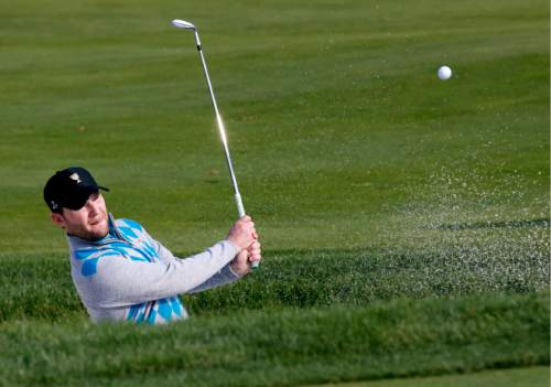 International team player Branden Grace of South Africa plays from a bunker on the eighth hole during his four ball match at the Presidents Cup golf tournament at the Jack Nicklaus Golf Club Korea, in Incheon, South Korea, Saturday, Oct. 10, 2015.(AP Photo/Lee Jin-man)