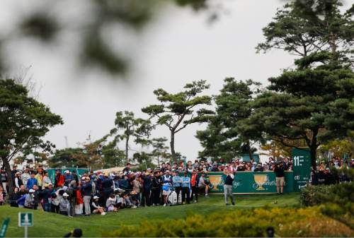 United States' Phil Mickelson hits off the 11th tee during his four ball match at the Presidents Cup golf tournament at the Jack Nicklaus Golf Club Korea, in Incheon, South Korea, Saturday, Oct. 10, 2015.(AP Photo/Woohae Cho)