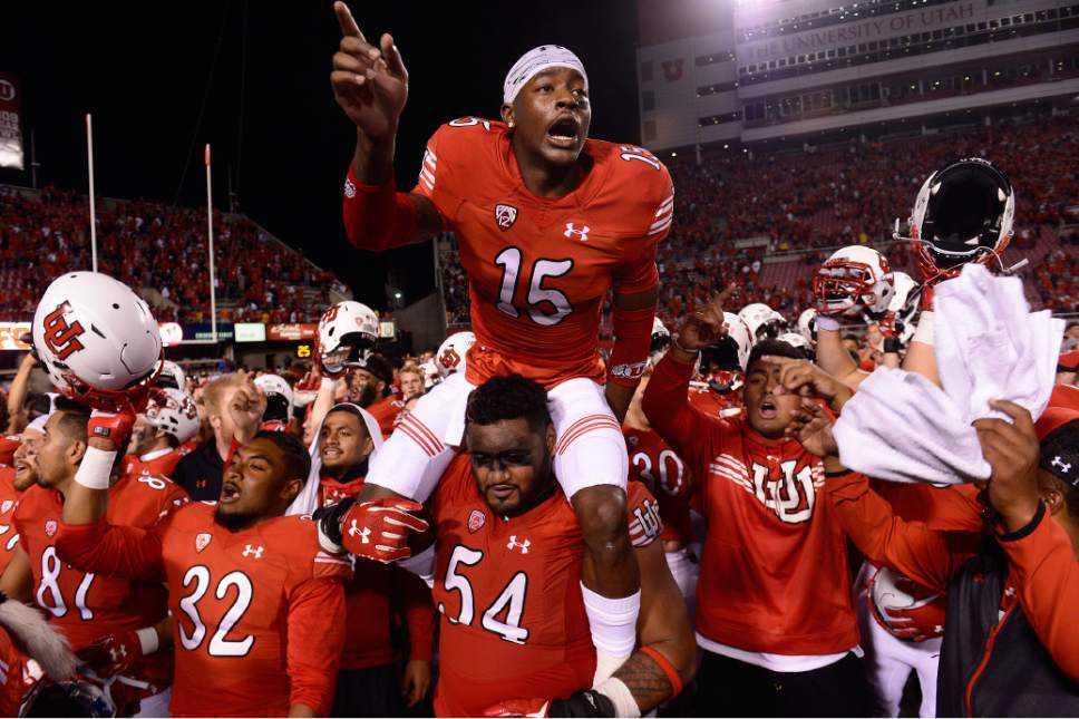 Scott Sommerdorf   |  The Salt Lake Tribune Utah DB Dominique Hatfield celebrates on the shoulders of G Isaac Asiata after Utah beat Cal 30-24, Saturday, October 10, 2015.