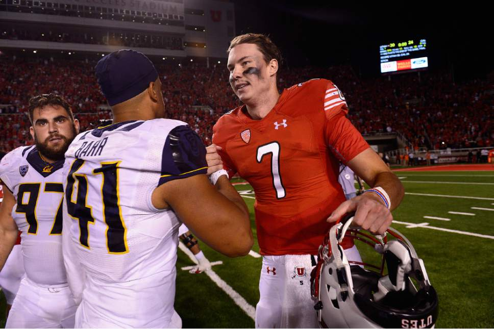 Scott Sommerdorf   |  The Salt Lake Tribune Utah QB Trevor Wilson gets congratulations from Cal's DE Todd Barr. Utah beat Cal 30-24, Saturday, October 10, 2015.