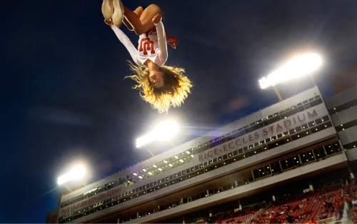 "Scott Sommerdorf   |  The Salt Lake Tribune Cheerleader Ashley Harrison completes a ""basket toss, full"" prior to the Cal vs Utah football game, Saturday, October 10, 2015."