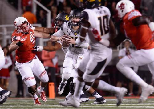 Scott Sommerdorf   |  The Salt Lake Tribune Utah DL Hunter Dimick and the Utah defense forces Cal QB Jared Goff out of he pocket during first half play. Utah held a 24-17 lead at the half, Saturday, October 10, 2015.