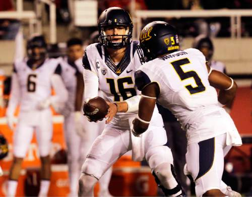 California quarterback Jared Goff (16) hands off the ball to California running back Tre Watson (5) in the first half of an NCAA college football game against Utah on Saturday, Oct. 10, 2015, in Salt Lake City. (AP Photo/Kim Raff)
