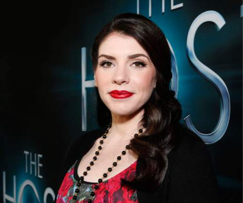 """FILE - In this Tuesday, March 19, 2013, file photo, author Stephenie Meyer arrives at the LA premiere of """"The Host"""" at the ArcLight Hollywood in Los Angeles. Ten years after the debut of her million-selling """"Twilight"""" novels, Meyer is planning to talk about them at New York Comic Con in October 2015. (Photo by Todd Williamson/Invision/AP, File)"""