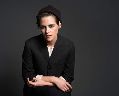 """In this Oct. 8, 2014 photo, actress Kristen Stewart poses for a portrait in New York. Stewart stars in """"The Clouds of Sils Maria,"""" directed by French filmmaker Olivier Assayas, opening in theaters April 10. (Photo by Drew Gurian/Invision/AP)"""