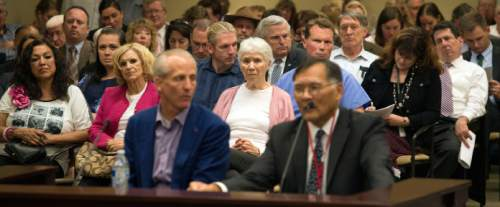 Steve Griffin      Tribune file photo  The public listens to Senate President Wayne Niederhauser and Sen. Brian E. Shiozawa, R-Salt Lake City, last week as they addressed the Health Reform Task Force during a meeting to discuss where Utah is at on covering low-income residents falling in the current insurance gap. The plan hammered out by the governor and legislative leaders was roundly rejected by Republican lawmakers.