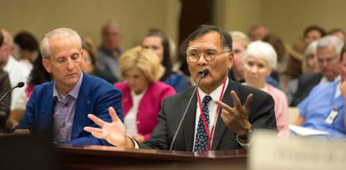 Steve Griffin     The Salt Lake Tribune  Senate President Wayne Niederhauser, left, listens as Sen. Brian E. Shiozawa, R-Salt Lake City, addresses the Health Reform Task Force during a meeting to discuss where Utah is at on covering low-income residents falling in the current insurance gap. The meeting was held at the House Building on capitol hill  in Salt Lake City, Tuesday, October 6, 2015.