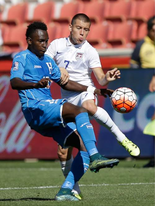 Honduras forward Alberth Elis (17) and United States defender Dillon Serna (7) battle for the ball during the second half of a CONCACAF men's Olympics semifinal qualifying soccer match, Saturday, Oct. 10, 2015, in Sandy, Utah. (AP Photo/Rick Bowmer)