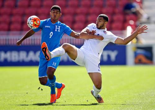 Honduras forward Antony Lozano (9) battles for the ball against United States defender Cameron Carter-Vickers (4) during the first half of a CONCACAF men's Olympics semifinal qualifying soccer match, Saturday, Oct. 10, 2015, in Sandy, Utah. (AP Photo/Rick Bowmer)