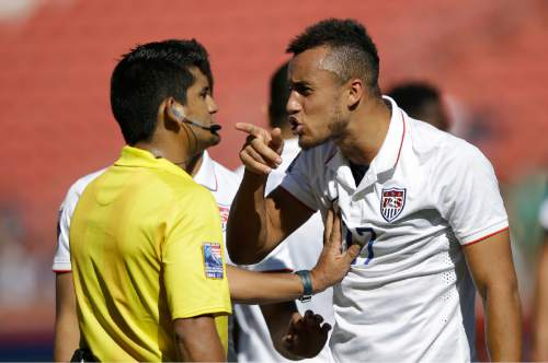 United States forward Jerome Kiesewetter (17) argues with the referee during the second half of a CONCACAF men's Olympics semifinal qualifying soccer match against Honduras Saturday, Oct. 10, 2015, in Sandy, Utah. (AP Photo/Rick Bowmer)