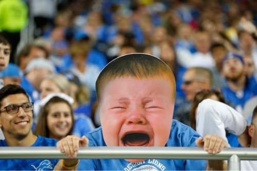 A Detroit Lions fan wears a enlarged baby face during the second half of an NFL football game against the Arizona Cardinals, Sunday, Oct. 11, 2015, in Detroit. (AP Photo/Paul Sancya)