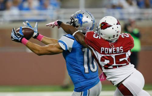 Detroit Lions wide receiver Corey Fuller (10), defended by Arizona Cardinals cornerback Jerraud Powers (25), catches a 48-yard pass during the first half of an NFL football game, Sunday, Oct. 11, 2015, in Detroit. (AP Photo/Duane Burleson)