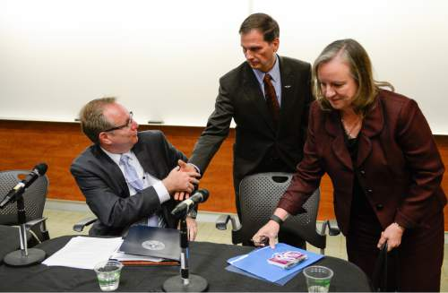 Francisco Kjolseth | The Salt Lake Tribune Congressman Chris Stewart shakes hands with Dave Winberg, Director of the NSA Operations Center in Utah following a panel discussion as part of a national security conference hosted by Congressman Stewart on the University of Utah campus on Tuesday, Oct. 13, 2015. At right is Major General Jennifer Napper (US Army retired), Unsys.