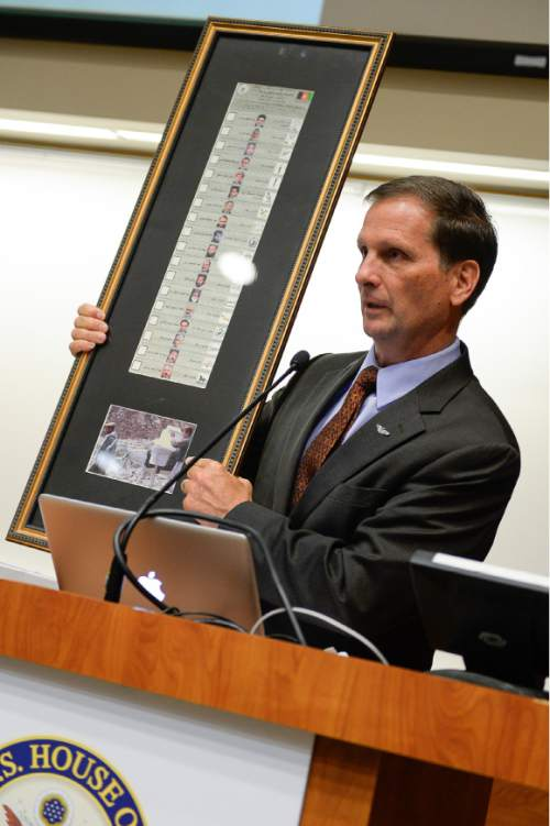 Francisco Kjolseth | The Salt Lake Tribune Congressman Chris Stewart holds up a framed copy of the first elections ballot in Afghanistan as he begins a National Security Conference at the University of Utah on Tuesday, Oct. 13, 2015.
