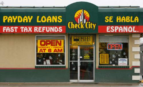 Leah Hogsten  |  Tribune file photo Payday loan company Check City operates at 2120 S. State St. in Salt Lake City. After years of having a relatively free reign in the state, legislative remedies are on the horizon and several cities have capped the number of  payday loan industry outlets. The stores are and depict to whom the industry caters.
