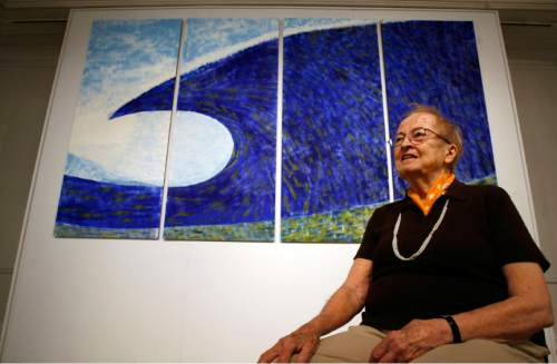 """Tribune file photo Anna Bliss is pictured by her piece """"Tsunami"""", oil on rives paper, in 2009 The acclaimed Utah artist died this week at age 90."""
