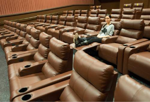 Rick Egan  |  The Salt Lake Tribune  Madelyn Rybczyk, marketing manager of Cinemark Theatres, demonstrates the new reclining chairs in all of the auditoriums in the newly renovated Cinemark Sugar House Theater.