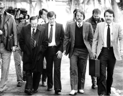 |  Tribune file photo  Ron Yengich (wearing white boots) walks to court with Mark Hofmann (center) for court proceedings in Salt Lake City..