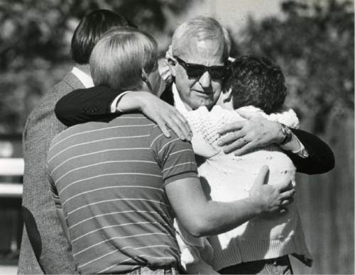 Tribune file photo J. Gary Sheets, center, is comforted by his daughter, Katie Robertson, after arriving at his Salt Lake City home where his wife had been killed in a bomb explosion.