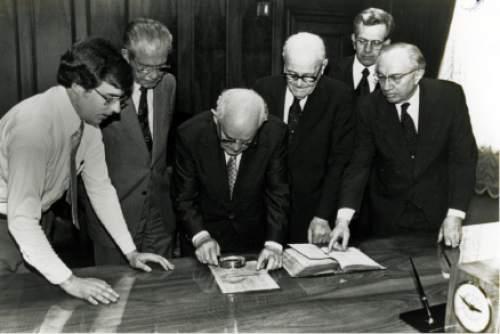Tribune file photo Mark W. Hofmann, left, and LDS Church leaders N. Eldon Tanner, Spencer W. Kimball, Marion G. Romney, Boyd K. Packer and Gordon B. Hinckley examine the Anthon transcript April 22, 1980.