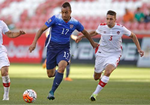 United States forward Jerome Kiesewetter (17)  brings the ball up field while Canada midfielder Giuliano Frano (3) pursues during a CONCACAF Men's Olympic qualifying soccer match Tuesday, Oct. 13, 2015, in Salt Lake City. The United States won 2-0. (AP Photo/Rick Bowmer)