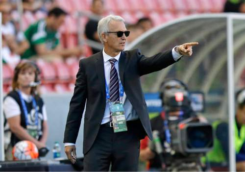 Canada head coach Benito Floro points to the field during the CONCACAF Men's Olympic qualifying soccer match against the United States, Tuesday, Oct. 13, 2015, in Salt Lake City. (AP Photo/Rick Bowmer)