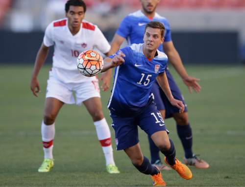 United States midfielder Marc Pelosi (15) goes after the ball as Canada forward Caleb Clarke (10) looks on in the first half of a CONCACAF Men's Olympic qualifying  soccer match Tuesday, Oct. 13, 2015, in Salt Lake City. (AP Photo/Rick Bowmer)