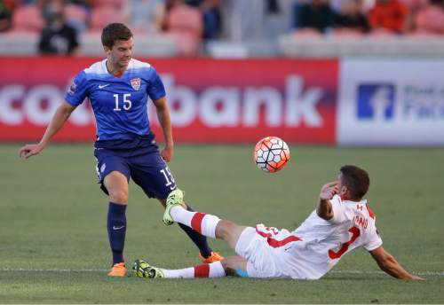 Canada midfielder Giuliano Frano (3) tackles United States midfielder Marc Pelosi (15) in the first half of a CONCACAF Men's Olympic qualifying  soccer match Tuesday, Oct. 13, 2015, in Salt Lake City. (AP Photo/Rick Bowmer)