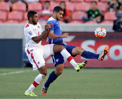 Canada forward Anthony Jackson-Hamel, left, and United States defender Cameron Carter-Vickers (4) battle for the ball in the first half of a CONCACAF Men's Olympic qualifying  soccer match Tuesday, Oct. 13, 2015, in Salt Lake City. (AP Photo/Rick Bowmer)