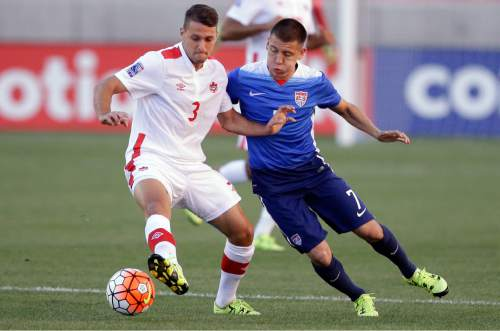 Canada midfielder Giuliano Frano (3) and United States defender Dillon Serna (7) battle for the ball in the first half of a CONCACAF Men's Olympic qualifying  soccer match Tuesday, Oct. 13, 2015, in Salt Lake City. (AP Photo/Rick Bowmer)