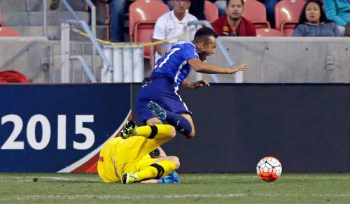 Canada goalkeeper Maxime Crepeau, bottom, fouls United States forward Jerome Kiesewetter in the second half of a CONCACAF Men's Olympic qualifying soccer match Tuesday, Oct. 13, 2015, in Salt Lake City. The United States won 2-0. (AP Photo/Rick Bowmer)