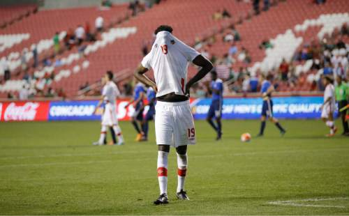 Canada defender Skylar Thomas (19) walks off the field following their CONCACAF Men's Olympic qualifying soccer match against the United States,  Tuesday, Oct. 13, 2015, in Salt Lake City. The United States won 2-0. (AP Photo/Rick Bowmer)