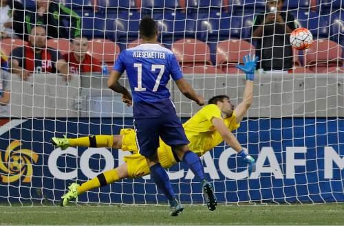 United States  forward Jerome Kiesewetter (17) scores a penalty shot on Canada goalkeeper Maxime Crepeau in the second half of a CONCACAF Men's Olympic qualifying soccer match Tuesday, Oct. 13, 2015, in Salt Lake City. The United States won 2-0. (AP Photo/Rick Bowmer)
