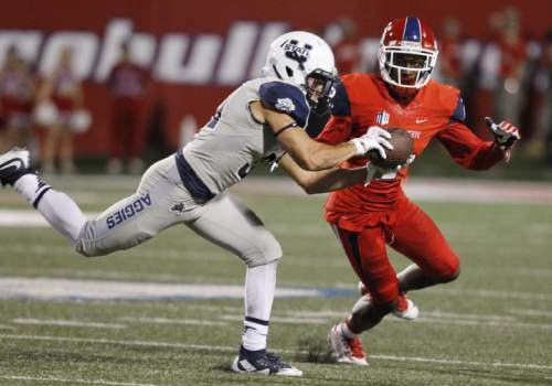 Utah State's Jentz Painter intercepts a pass intended for Fresno State's Jamire Jordan during the second half of an NCAA college football game in Fresno, Calif., Saturday, Oct. 10, 2015. (AP Photo/Gary Kazanjian)