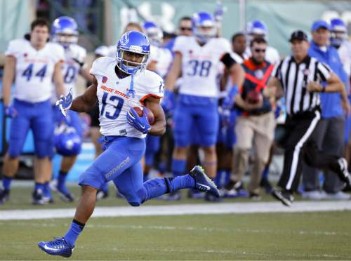 Boise State running back Jeremy McNichols (13) carries long for a touchdown in an NCAA college football game against Colorado State, Saturday, Oct. 10, 2015 in Fort Collins, Colo. (AP Photo/Brennan Linsley)
