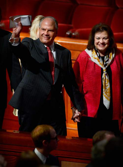 Scott Sommerdorf   |  The Salt Lake Tribune Elder Ronald A. Rasband leaves the morning session of the 185th Semiannual General Conference with his wife Melanie Rasband, Sunday, October 4, 2015.