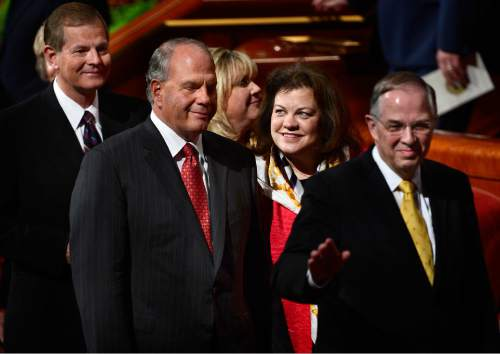 Scott Sommerdorf   |  The Salt Lake Tribune Melanie Rasband looks proudly at her husband, Elder Ronald A. Rasband as they leave the morning session of the 185th Semiannual General Conference, Sunday, October 4, 2015.