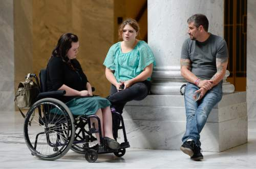 Francisco Kjolseth | Tribune file photo Representing the tens of thousands of low-income Utahns in need of help, Stacy Stanford, left, is joined by Kylie Toponce who has already filed for bankruptcy at 24 years old and might have Crohn's disease and Dan Davidson, who's in long term recovery. The three gathered at the Utah Capitol on Tuesday, Oct. 13, 2015, anxiously awaiting news as the House Republican Caucus went into a closed-door session to take a straw vote on the latest Medicaid-expansion plan, Utah Access Plus. The House GOP soundly rejected the plan.
