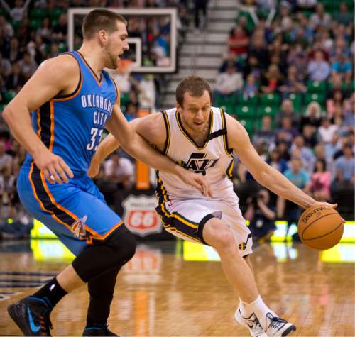 Lennie Mahler  |  The Salt Lake Tribune  Joe Ingles drives around Mitch McGary in the first half of a game between the Utah Jazz and Oklahoma City Thunder at EnergySolutions Arena on Saturday, March 28, 2015.